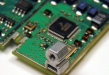 Installed surface-mount right-angle fastener on a board.